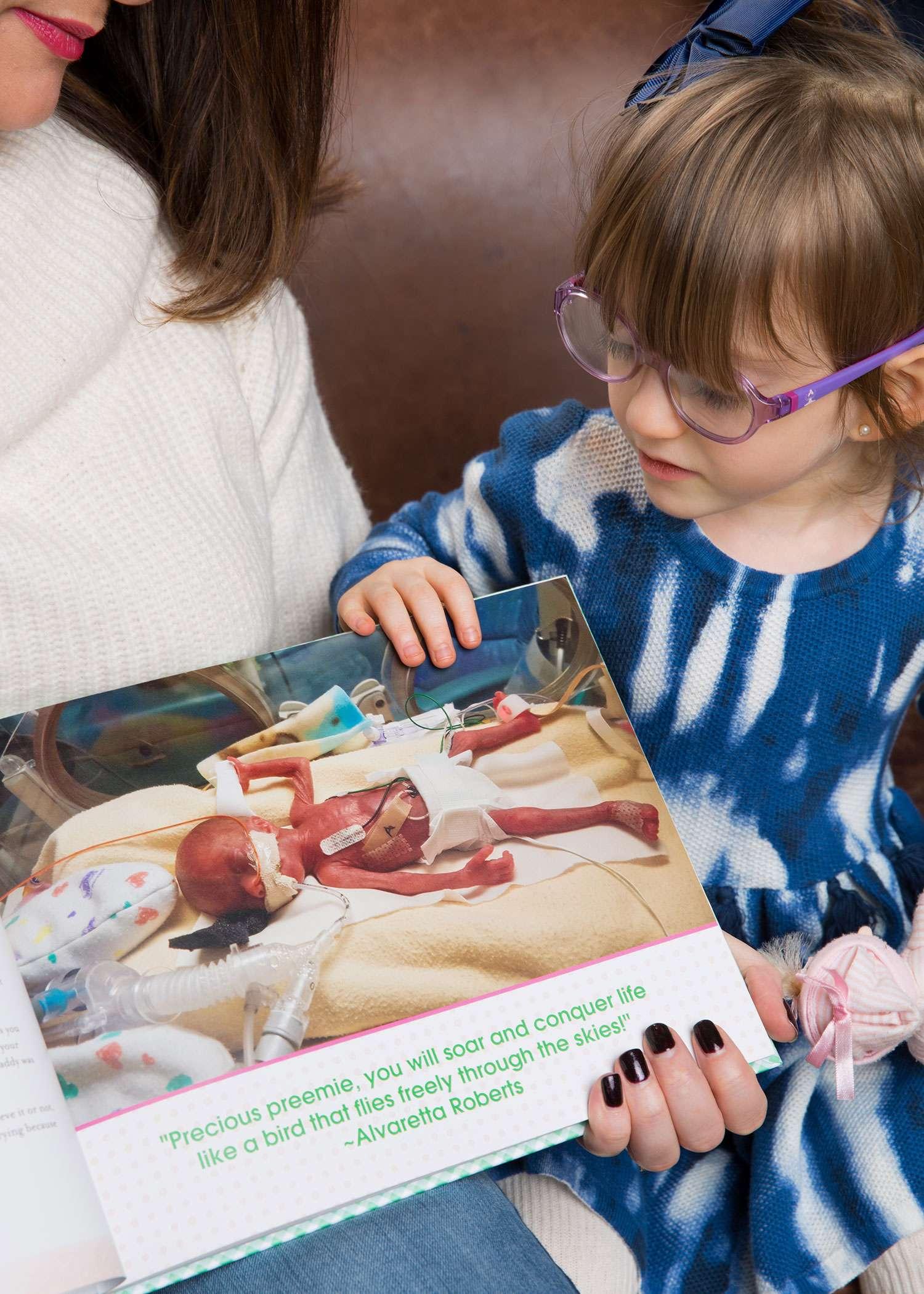 Lana looking at her preemie photos